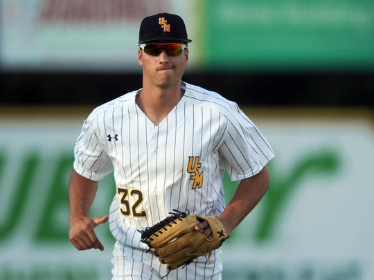 Southern Miss player Matt Wallner jogs in after the first inning in a game against UAB on Friday at Pete Taylor Park.