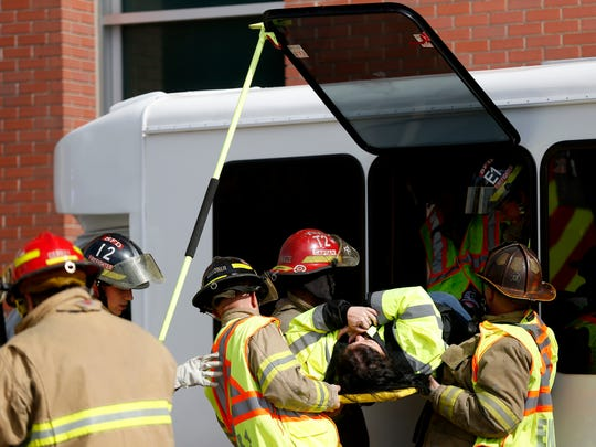 A person is removed from a window by firefighters after