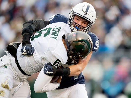 Penn State defensive end Garrett Sickels sacks Michigan State quarterback Damion Terry (6) during an NCAA college football game in State College, Pa., Saturday Nov. 26, 2016. (Abby Drey /Centre Daily Times via AP)