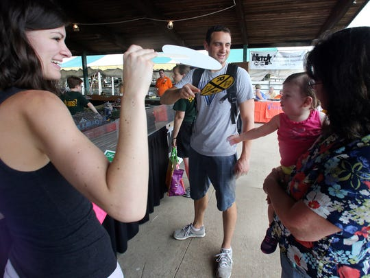 Second day of Somerset County 4-H Fair held at North Brach Park in Bridgewater on Thursday August 11, 2016.Here Casey (left) and Matt Scandura of Bridgewater use cardboard fans to keep their 18 month old baby Emma (right) cool while they seek the shade of the Model Train Tent at the fair.