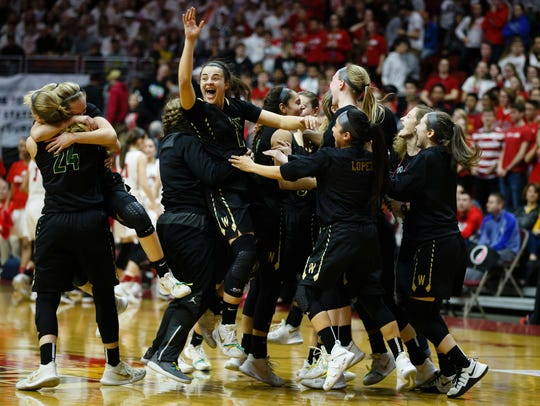 Iowa City, West's Rachael Saunders (13) celebrates