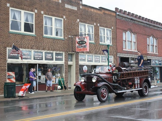 A 1932 Ford Howe pumper truck makes its way down Spring Street during the Vintage Fire Museum's Bicentennial Muster Parade.