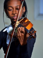A portrait of a violinist named Natalia.