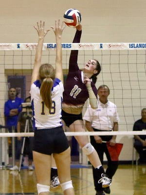 Erick Sifuentes / Special to The Caller-Times Tuloso-Midway's Victoria Barton taps the ball over Alamo Height's Abby Sanders during their Class 5A Regional Semifinals match at Dugan Wellness Center, A&M-CC Campus on Friday, Nov. 11, 2016.