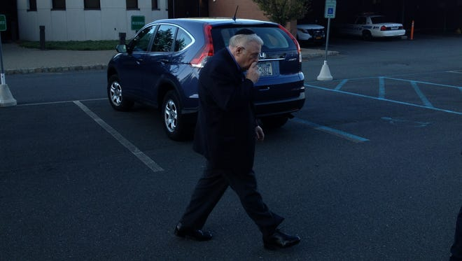 Shimon Sontag leaves Ramapo Town Hall on Sept. 22 after arraignment on felony counts of forgery, criminal possession of a forged instrument, and offering a false instrument for filing.