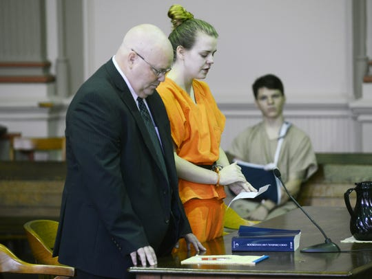 Emile Weaver reads a note while addressing the court