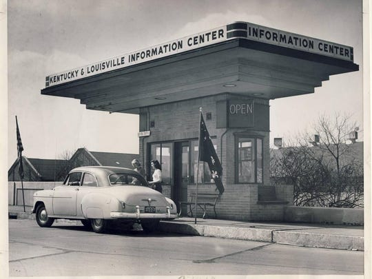 Attendants greet a driver in April of 1950 at the Kentucky & Louisville Information Center, which was created by remodeling a toll booth.