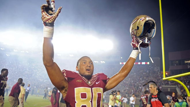 Sep 20, 2014; Tallahassee, FL, USA; Florida State Seminoles wide receiver Rashad Greene (80) celebrates an overtime win against the Clemson Tigers at Doak Campbell Stadium. Mandatory Credit: Melina Vastola-USA TODAY Sports