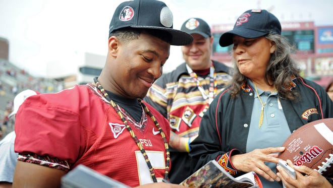Florida State quarterback Jameis Winston (5) signs autographs on Feb. 1 during the BCS National Championship Celebration at Doak Campbell Stadium.