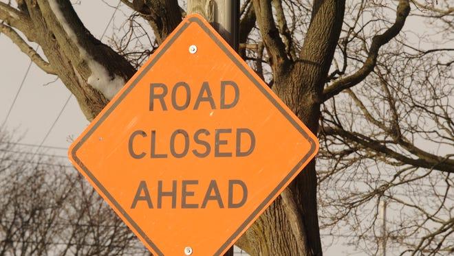 FILE - Road closed sign.