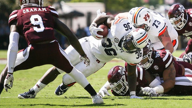 Auburn running back Kamryn Pettway gains extra yards in the red zone against Mississippi State during Saturday's game at Davis Wade Stadium in Starkville, Miss.