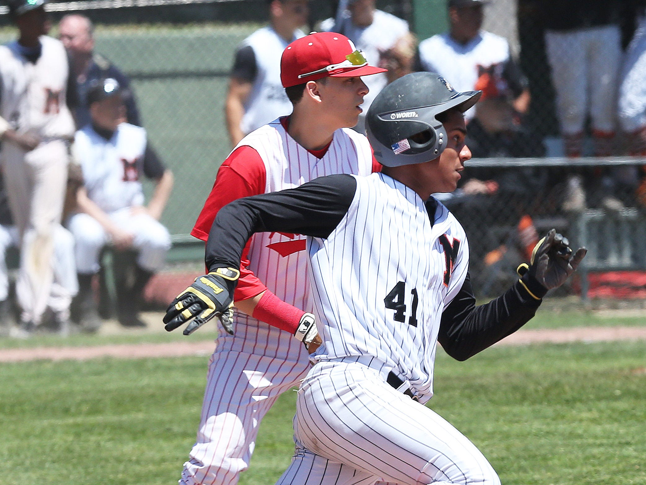 Mamaroneck's Kumar Nambiar rounds first on his way to second with a bases clearing double against North Rockland in a boys baseball playoff game at Mamaroneck High School on Saturday, May 23, 2015. Mamaroneck won the game 5-3.