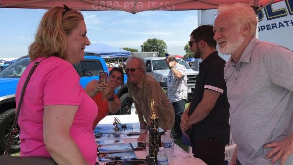 "Mike Lookinland, center, who starred as Bobby Brady on ""The Brady Bunch,"" and Donny Most, right, who played Ralph Malph on ""Happy Days,"" greet fans at the 2019 Powerlight Abe Lincoln Car and Bike Show."