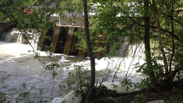 This spillway, which runs from the Erie Canal to Thomas Creek, overflowed Friday. Water levels remain high.