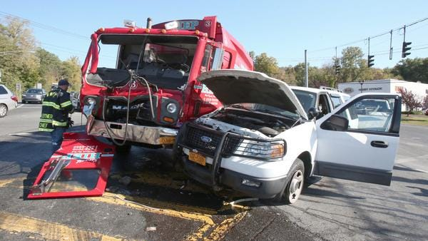 This garbage truck and SUV were part of an accident Thursday that closed Route 303 at Snake Hill Road in West Nyack.