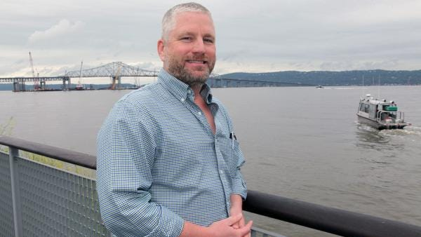 Christopher Horton poses in front of the Tappan Zee Bridge construction site June 11, 2014. Horton is the Tappan Zee Constructors operating engineer who oversees every person operating a piece of machinery on this site.