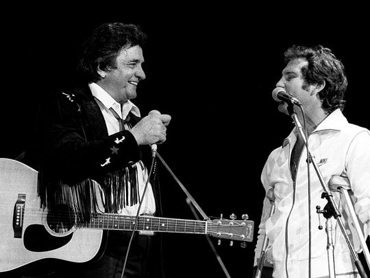 Johnny Cash performs with Larry Gatlin at the CBS Records
