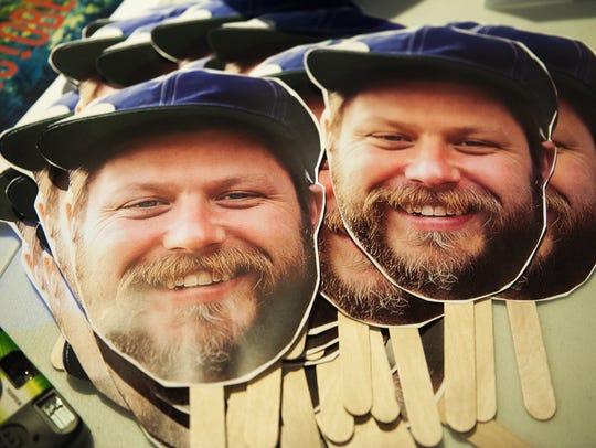 Cardboard masks bearing the image of Nick Mavodones