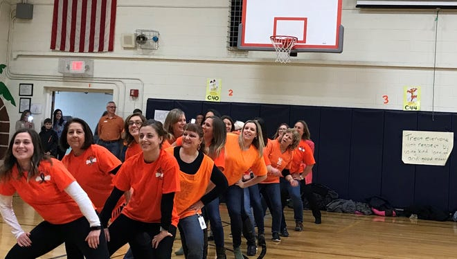 Warren's Central School staff performing an organized dance at the Dance-a-thon held on Friday, Feb.23.