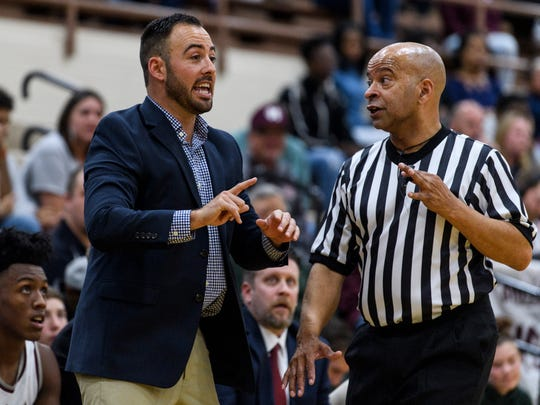 Henderson Head Coach Tyler Smithhart argues with a call made by the referees during the game against the Warren Central Dragons at Henderson County High School in Henderson, Ky., Tuesday, Nov. 28, 2017. Despite leading in the first half, the Colonels fell to the Dragons, 87-64.