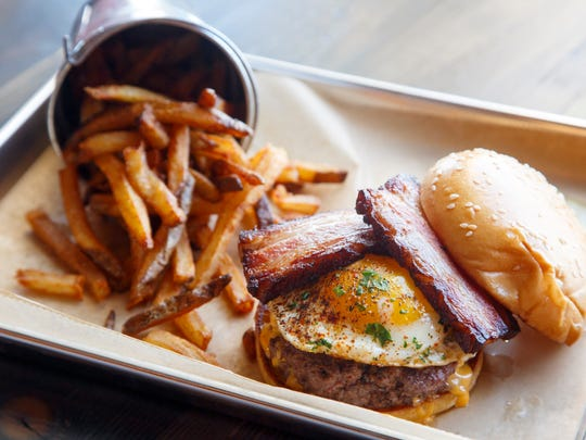 The Brewer's Burger with braised bacon, fried egg and