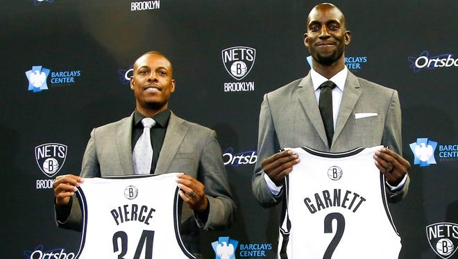 Paul Pierce and Kevin Garnett are introduced by the Brooklyn Nets after being acquired by the Boston Celtics.