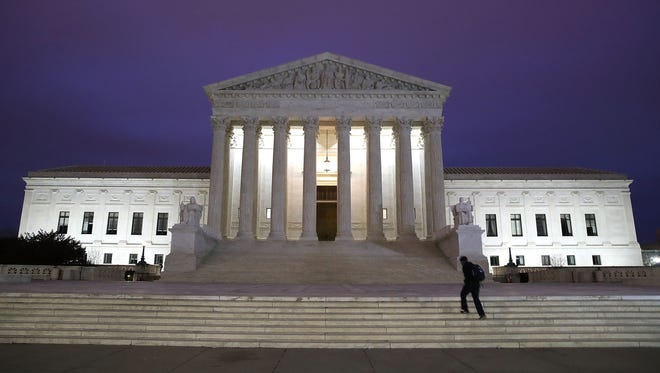 A man walks up the steps of the U.S. Supreme Court on Jan. 31, 2017.