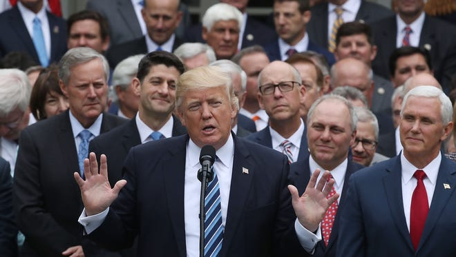 U.S. President Donald Trump (C) speaks while flanked by House Republicans after they passed legislation aimed at repealing and replacing ObamaCare, during an event in the Rose Garden at the White House, on May 4, 2017 in Washington, DC. The House bill would still need to pass the Senate before being signed into law.