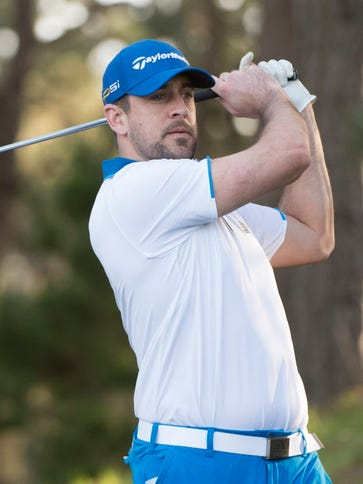Aaron Rodgers tees off on the second hole during the