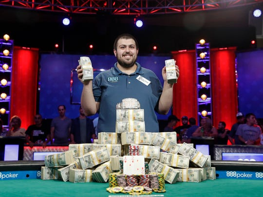 Scott Blumstein poses for photographers after winning the World Series of Poker main event, Sunday, July 23, 2017, in Las Vegas.