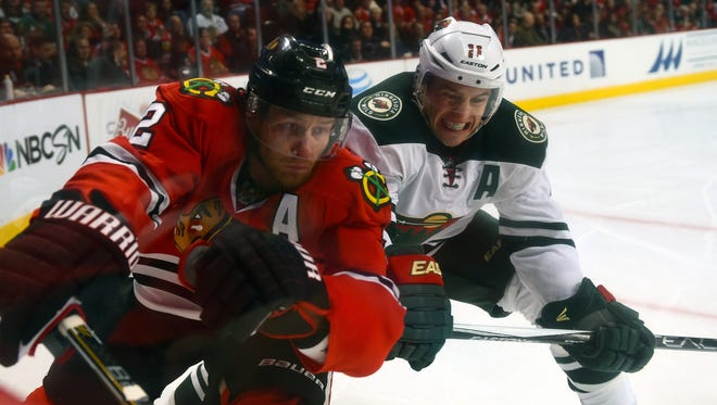 Minnesota winger Zach Parise (11), checks Chicago Blackhawks defenseman Duncan Keith, is the offensive catalyst for the Wild.