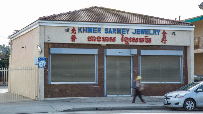 Prosecutors dropped criminal charges against four people linked to Khmer Sarmey Jewelry in Long Beach, Calif. because they concluded that wiretaps the DEA used in a money laundering investigation were illegal.