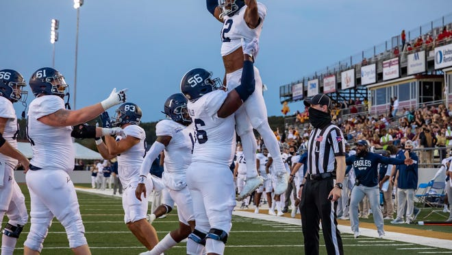 In a Savannah connection within the Georgia Southern team, offensive lineman Brian Miller, a Memorial Day School graduate, lifts Wesley Kennedy III, a Benedictine graduate, after Kennedy scored a touchdown against host ULM on Saturday night in Monroe, Louisiana. Georgia Southern won 35-30.