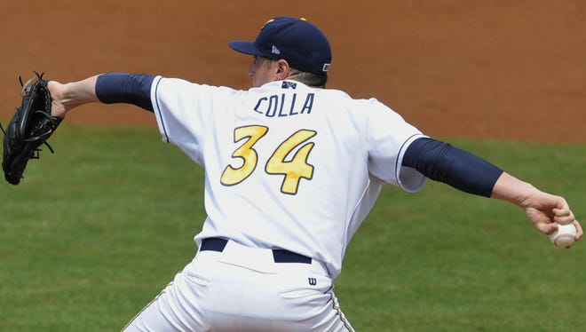 Biscuits pitcher Michael Colla gave up two runs in five innings to take the loss Tuesday.