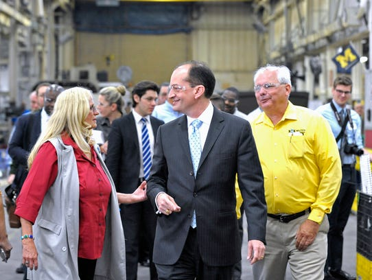 U.S. Secretary of Labor Alexander Acosta, center, tours