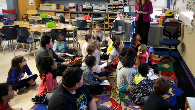 Third grade teacher Linda Peterson leads a discussion during classes at Brown Deer Elementary School. Voters on April 3 approved a $25.9 million referendum to alleviate overcrowding at the school, as well as long-term maintenance projects.