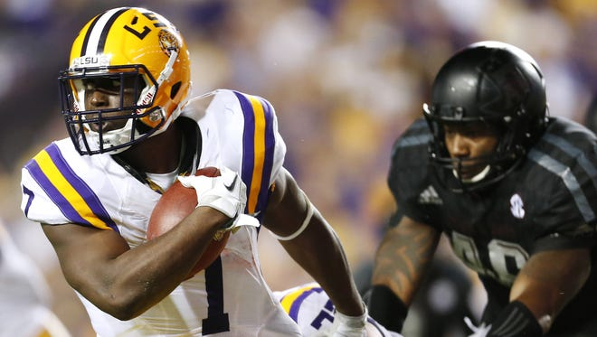 LSU running back Leonard Fournette (7) runs with the ball during the first half an NCAA college football game against Texas A&M in Baton Rouge, La., Saturday, Nov. 28, 2015. (AP Photo/Jonathan Bachman)