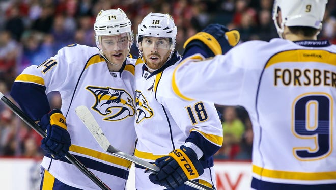 Predators left wing James Neal (18) celebrates his goal with teammates in the second period Friday.