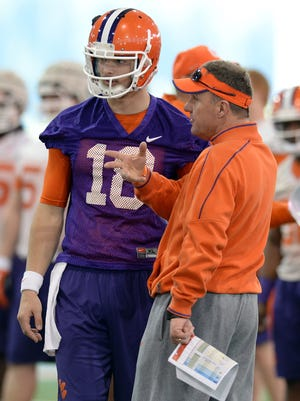 Clemson offensive coordinator Chad Morris talks with quarterback Cole Stoudt (18) during the opening day of spring practice Wednesday, March 5, 2014.