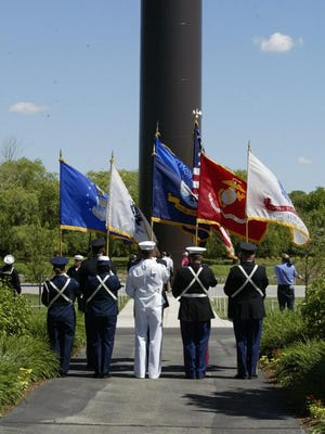 A joint armed forces color guard participates in a patriotic dedication ceremony of the Acuity flagpole on Monday June 16, 2014.