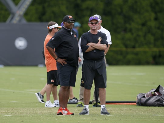 Cincinnati Bengals head coach Marvin Lewis and Minnesota Vikings head coach Mike Zimmer talk on the sideline during practice on Day 13 of training camp at the Paul Brown Stadium practice facility in downtown Cincinnati on Wednesday, Aug. 10, 2016. The Bengals and Vikings met on the practice field for the first of two joint practices ahead the first pre-season game of the year.