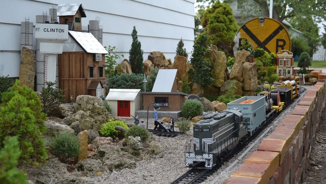 Steve Tusen's model railroad includes live miniature trees and buildings with Port Clinton connections.
