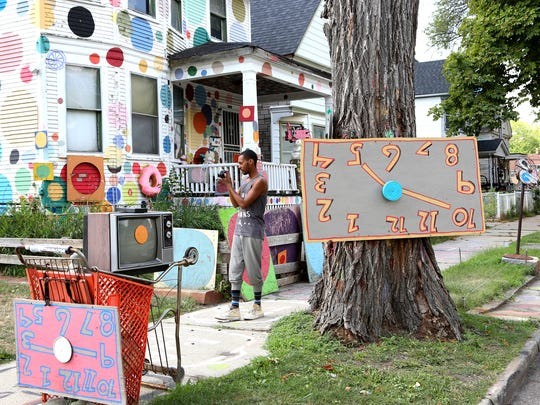 Joshua L. Dalton of Ecorse takes photos and video on his first visit to the Heidelberg art project, the ever evolving art installation on Heidelberg street in Detroit by artist Tyree Guyton.