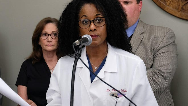Bastrop County Health Authority Dr. Desmar Walkes talks to reporters on March 16 about the county's emergency declaration in response to the coronavirus pandemic. Bastrop County has begun distributing doses of the Moderna COVID-19 vaccine.