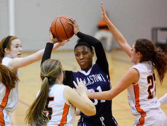 Dallastown's Amari Johnson, surrounded by Central York defenders, looks to pass during a girls' basketball game at Central York High School on Tuesday. Johnson scored 19 points and pulled down 18 rebounds in Dallastown's 55-50 overtime win. (Kate Penn -- GameTimePA.com)