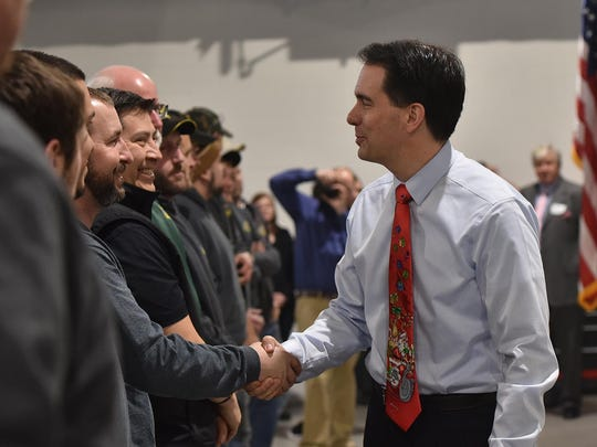 Gov. Scott Walker greets Pro Products Inc. employees following his speech to invited guests of the machine specialist company in Sturgeon Bay on Friday