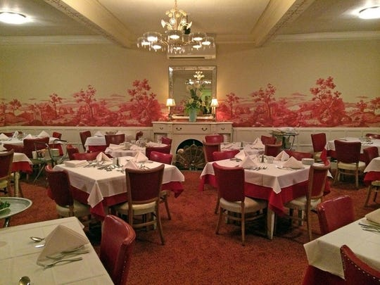 The Union Hotel's restaurant dining room features original wainscoting and toile wallpaper, installed in 1960 and restored in 2015.