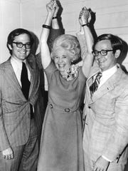 Mrs. Robert L. (Martha) Ashe is joined by her sons after winning the Seventh District Senate race as the Republican candidate on Nov. 5, 1974. Mrs. Ashe ran as a stand-in for her son, Victor, right, after the Supreme Court ruled he didn't meet the age requirement. Her other son, R. Lawrence Ashe Jr., came from Atlanta, to help celebrate the occasion.