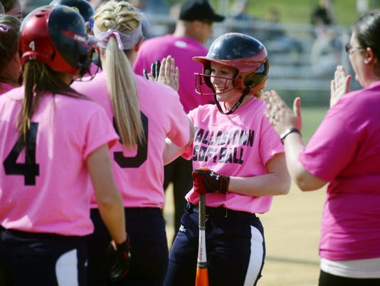Dallastown's Haylee Anders is greeted by teammates after hitting a two-run home run in the second inning of the Wildcats' April 29 softball game against Red Lion. It was Anders' 100th-career hit, as Dallastown defeated Red Lion 15-5.