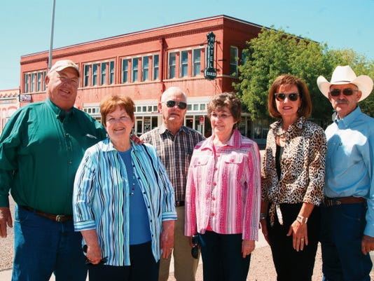 Committee members for the 102nd annual Old Timers' Association of Luna County Reunion stand in front of the Baker Hotel on historic Silver Avenue to promote the traditional weekend activities planned by the association members. From left are Co-presidents Russell and Dee Dee Baker, last year's co-presidents, J.D. and Billye Gray and co-vice presidents Merrianne and Kenny Treadwell.